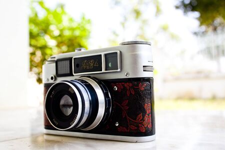 increasingly: LAMPANG, THAILAND - FEBRUARY 13: A Fed 4 vintage Russian film camera on February 13, 2012 in Lampang, Thailand. Film photography has become increasingly popular in Thailand in recent years.