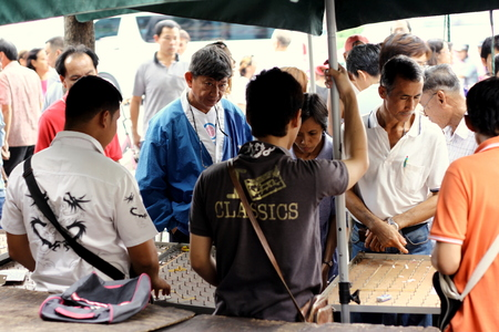 democracy Monument: BANGKOK, THAILAND - AUGUST 1: Unidentified people wait to buy lottery tickets near Democracy Monument on August 1, 2010 in Bangkok, Thailand.