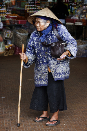 dalat: Dalat, Vietnam - May 27: An unidentified woman shops at a traditional market on May 27, 2012 in Dalat, Vietnam.