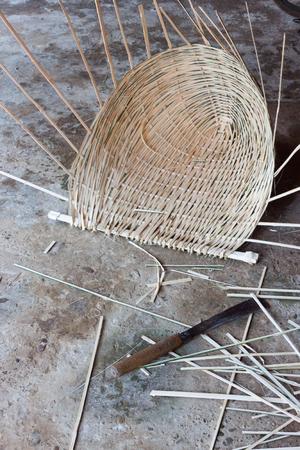 basketry: Half way finished home made bamboo basket at a workshop in Luang Prabang, Laos.