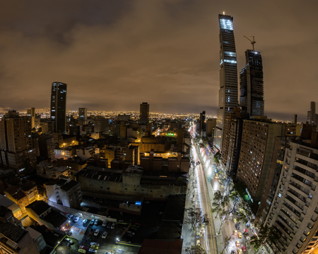 View of downtown Bogota, Colombia with a fisheye lens at night. Stock Photo