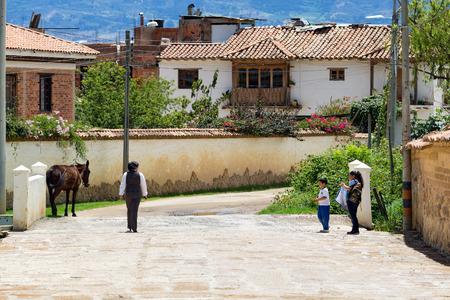 VILLA DE LEYVA, COLOMBIA - APRIL 29: Unidentified people walk down the street on April 29, 2016 in Villa de Leyva, Colombia. Editorial