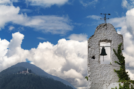 An old bell tower with Cerro de Guadalupe in the background in Bogota, Colombia.