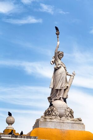 Birds land on statue at the Parque Del Centenario in Cartagena, Colombia.