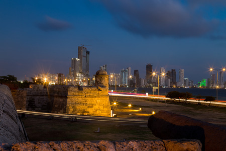 Blue hour long exposure view of Cartagenas colonial wall and Bocagrande in the distance. Stock Photo