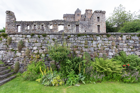 Beautiful gardens in the front of the remains of Castle Campbell near Dollar, Scotland.
