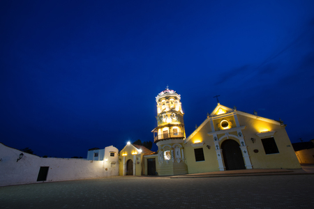 colonial church: The Santa Barbara Church during the evening in Mompox, Colombia. Stock Photo