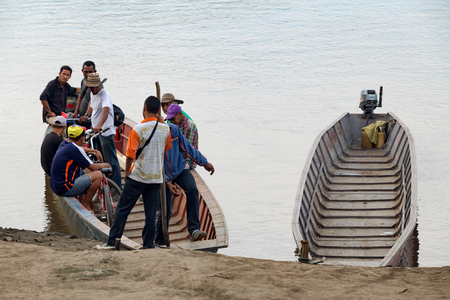 MOMPOX, COLOMBIA - MAY 27: Unidentified people get on a boat ferry in Mompox, Colombia on May 27, 2016.
