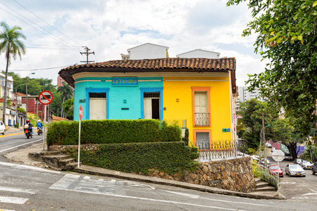 Brightly painted green and yellow house in Cali, Colombia.