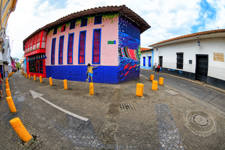 Brightly colored painted buildings in Cali, Colombia.