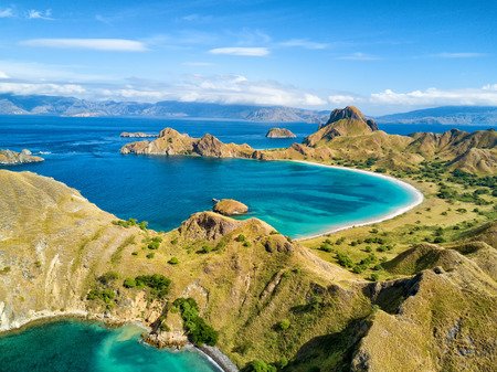 Aerial view of two beaches on Pulau Padar island in between Komodo and Rinca Islands near Labuan Bajo in Indonesia.