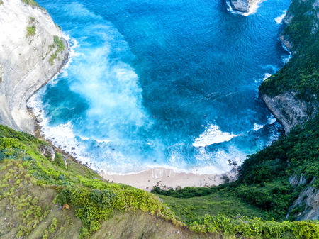 nusa: Aerial view of Paluang cliff and the beach below it near Klingking beach on Nusa Penida, Bali, Indonesia.