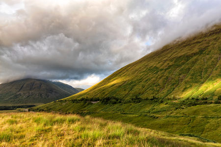 Clouds gather over Beinn Dorain and Beinn Odhar in the west highland of Scotland, United Kingdom. Stock Photo