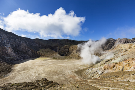 An active sulfur vent spits gasses inside the stratovolcano, Mount Egon in East Nusa Tenggara in Indonesia.  Stock Photo
