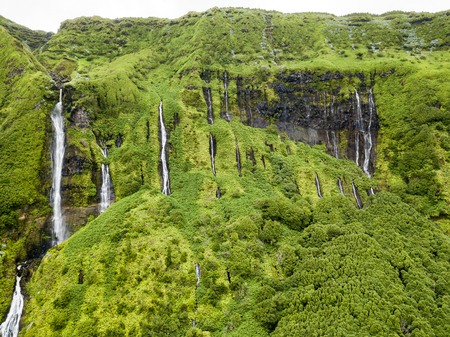 Aerial closeup view of the multitudes of waterfalls at Poca da Alagoinha near the small village of Fajazinha in Flores, a small island belonging to Portugal. Stock Photo
