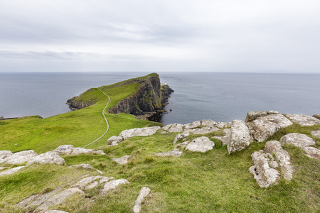 A small walking trail leading up to the Neist Point Lighthouse on Isle of Skye, Scotland.