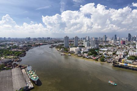 Aerial view looking upriver  of the Chao Phraya in Bangkok, Thailand.