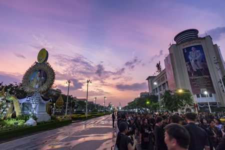 BANGKOK, THAILAND - OCTOBER 26: Unidentified people gather for the cremation of Rama IX at sunset on Ratchadamnoen Avenue in Bangkok, Thailand on October 26, 2017.