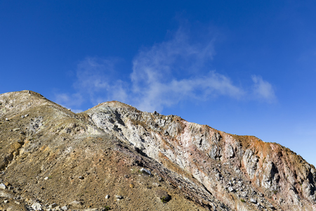 Barren volcanic landscape and its many colors on the summit of Mount Egon in Indonesia. Stock Photo