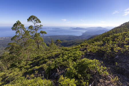 View of islands from a hike up to the summit of Mount Egon on Flores Island in Indonesia. Stock Photo