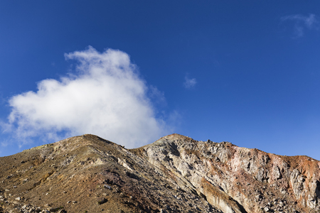 Sulphuric clouds emmited from the caldera near the summit of Mount Egon. Stock Photo