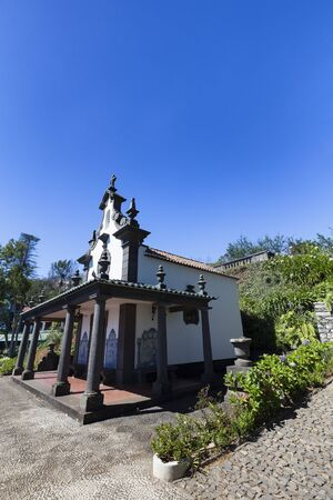 Clear blue summer sky over the Sancta Maria Chapel in Funchal on Madeira, Portugal.