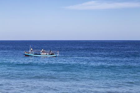 A fishing boat in the tropical waters near Paga, East Nusa Tenggara, Indonesia. Stock Photo