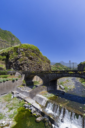 Portrait view of a bridge in the small village of Sao Vicente on the island of Madeira, Portugal. 写真素材