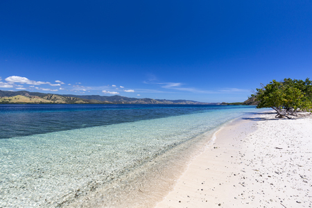 Beautiful warm tropical water on a beach in the Seventeen Island National Park in Flores, Indonesia.
