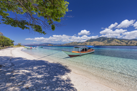 Boats on the beach on an island in the Seventeen Island National Park, Flores, Indonesia. Stock Photo