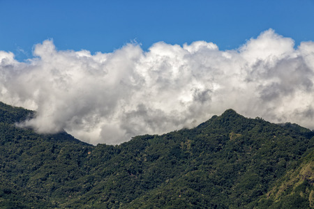 Clouds gather over mountains near the Bena traditional village in Flores, Indonesia.