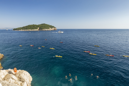 Summer recreation in the Adriatic sea outside the walled city of Dubrovnik.