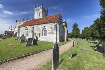 Ancient grave stones at the Saxon Sanctuary Church in Wootton Wawen, England. Archivio Fotografico - 123632335