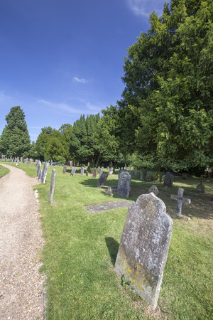 A path next to old grave stones in the Saxon Sanctuary Church in Wootton Wawen, England. Archivio Fotografico - 123633441
