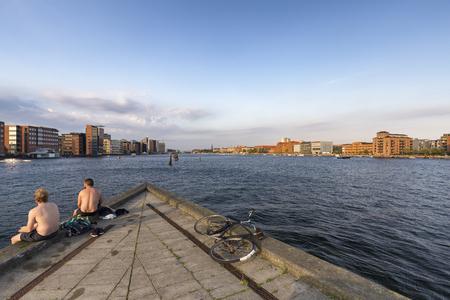 Late afternoon swimming in Copenhagen, Denmark. Archivio Fotografico - 123633529