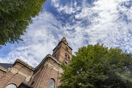 Low angle view of the Church of our Savior in Copenhagen, Denmark. Archivio Fotografico - 123633642