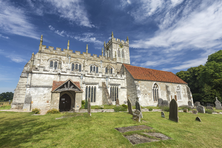 Summer sky over the Saxon Sanctuary Church in Wootton Wawen, England. Archivio Fotografico - 123633864