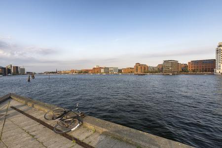 A bike next to a large canal in Copenhagen, Denmark. Archivio Fotografico - 123633958