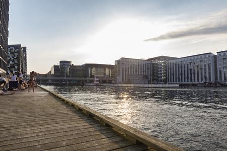 COPENHAGEN, DENMARK - AUGUST 26: Unidentified people gather near sunset to swim in Copenhagen, Denmark on August 26, 2016. Archivio Fotografico - 123571816