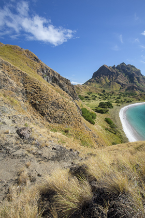 Portrait view of mountains and an empty beach on Pulau Padar island in the Komodo National Park.
