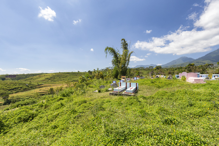 A Catholic cemetery next to a terraced rice field in Ruteng on the Island of Flores. 免版税图像