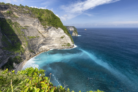 Interesting beach sediment interacting with the ocean at Puluang Cliff near Kelingking Beach on Nusa Penida in Indonesia.