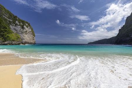 White water on Kelingking Beach on Nusa Penida in Indonesia.