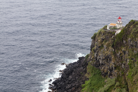 Beautiful view of the Faro do Arnel Lighthouse near Nordeste on Sao Miguel.