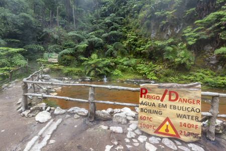 RIBEIRA GRANDE - PORTUGAL: Sign for extremely warm hot springs near Lagoa do Fogo and Ribeira Grande, Portugal on August 5, 2017.