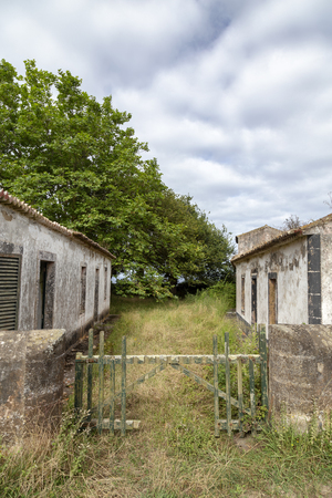 A portrait view of an abandoned homestead in Ginetes on Sao Miguel island in the Azores.