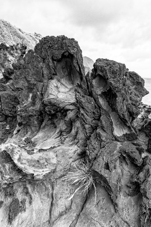 Black and white view of dramatic lava rock near Santa Cruz das Flores in the Azores.