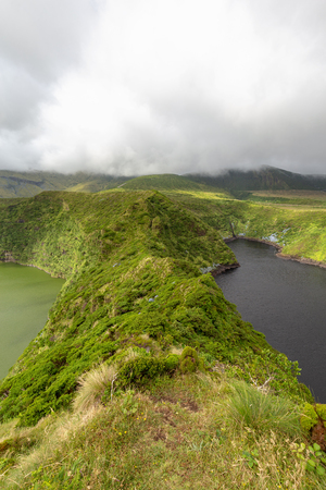 Portrait view of twin crater lakes on Flores island in the Azores. Imagens