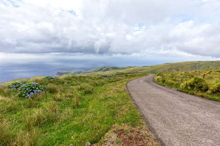 Clouds gather around Corvo island in the distance from Flores island in the Azores.
