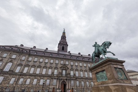 Looking up at the Christiansborg Palace and Frederik VII statue in Copenhagen, Denmark.
